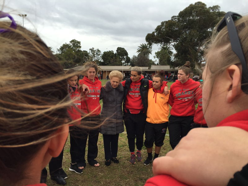 Moana and Susan in team huddle