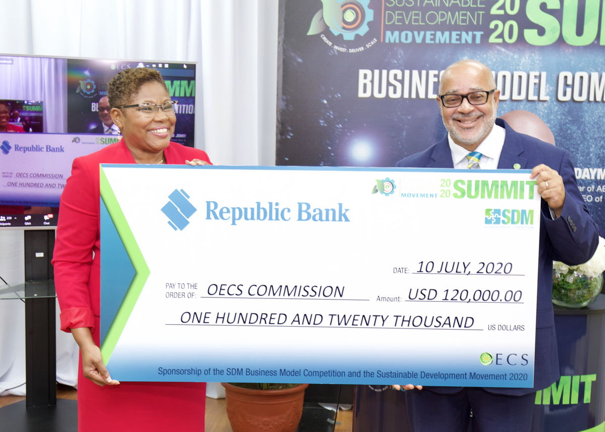 Managing Director of Republic Bank (EC) Limited, Michelle Palmer-Keizer, officially hands over the title sponsorship cheque to OECS Director General, Dr. Didacus Jules
