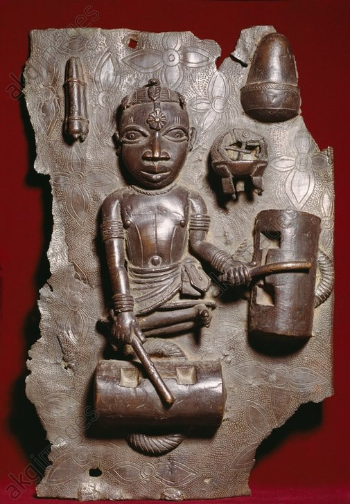 Drummer with two drums made of hollow tree trunks.<br/>West African, Benin, Nigeria, possibly early 17th century.<br/>Bronze relief.<br/>From the palace of the Oba in Benin.<br/>London, British Museum.<br/><br/>AKG585582