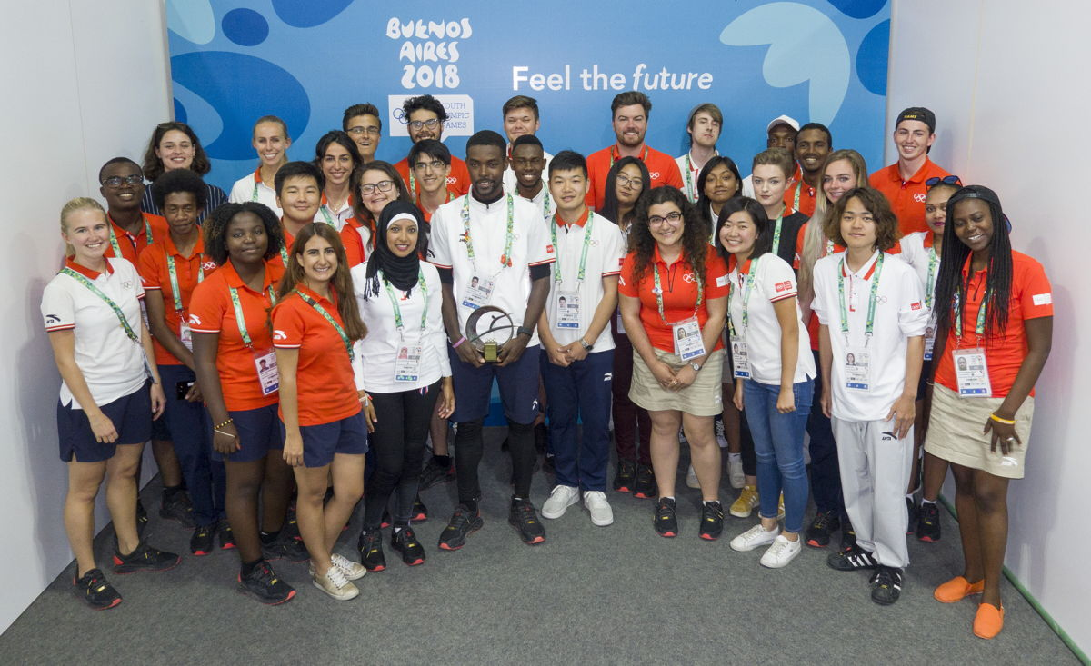 Sharome pictured with the IOC YR class of 2018, featuring the top Young Reporters from the Americas, Europe, Africa, Oceania and Asia.