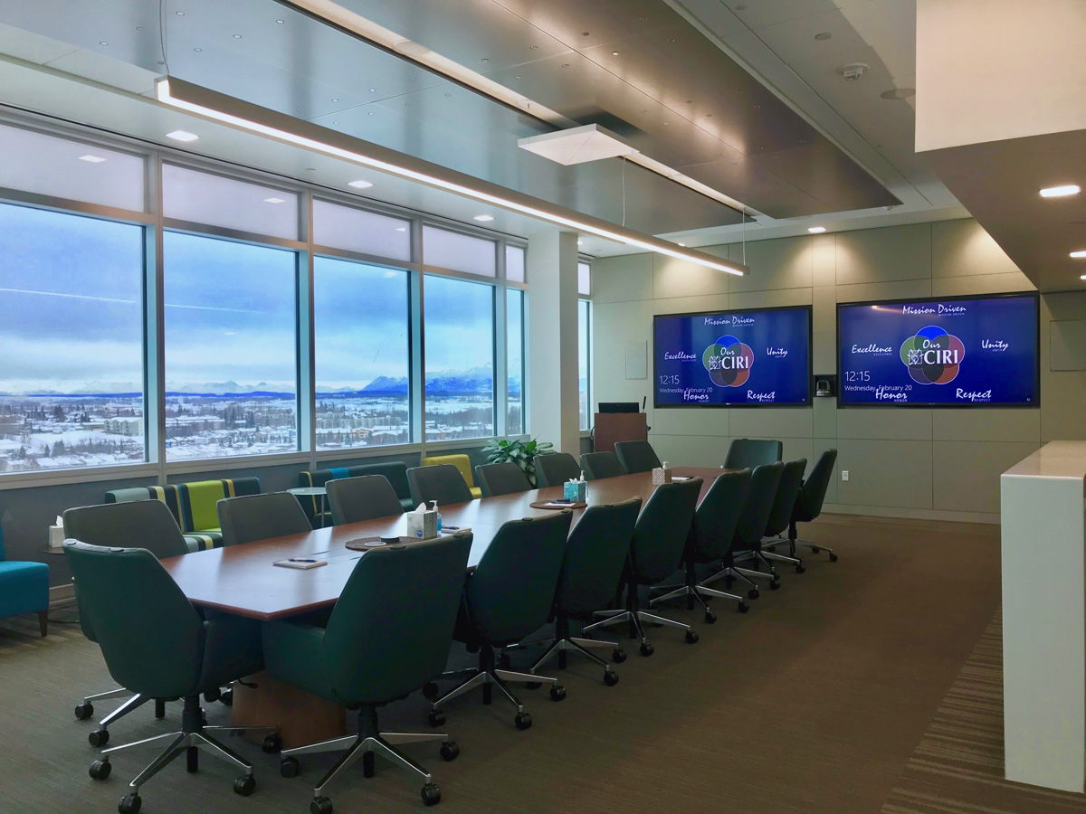 CIRI's executive boardroom located on the eighth floor of the Fireweed Business Center in Anchorage, Alaska, featuring the Sennheiser TeamConnect Ceiling microphone