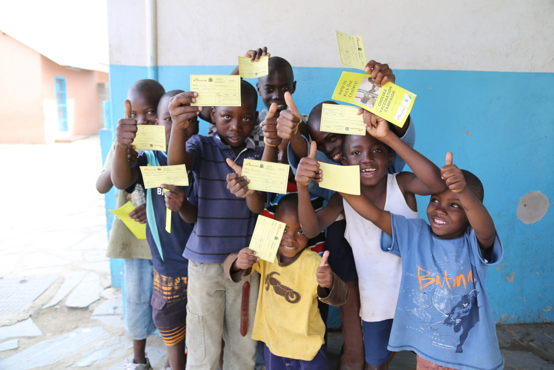 Children at the exit of the vaccination centre proudly showing their vaccination certificate<br/>Picture taken at Grace Centre, one of the 15 sites used by MSF in Kanyama district for a massive cholera vaccination campaign in Lusaka. Photographer: Laurence Hoenig