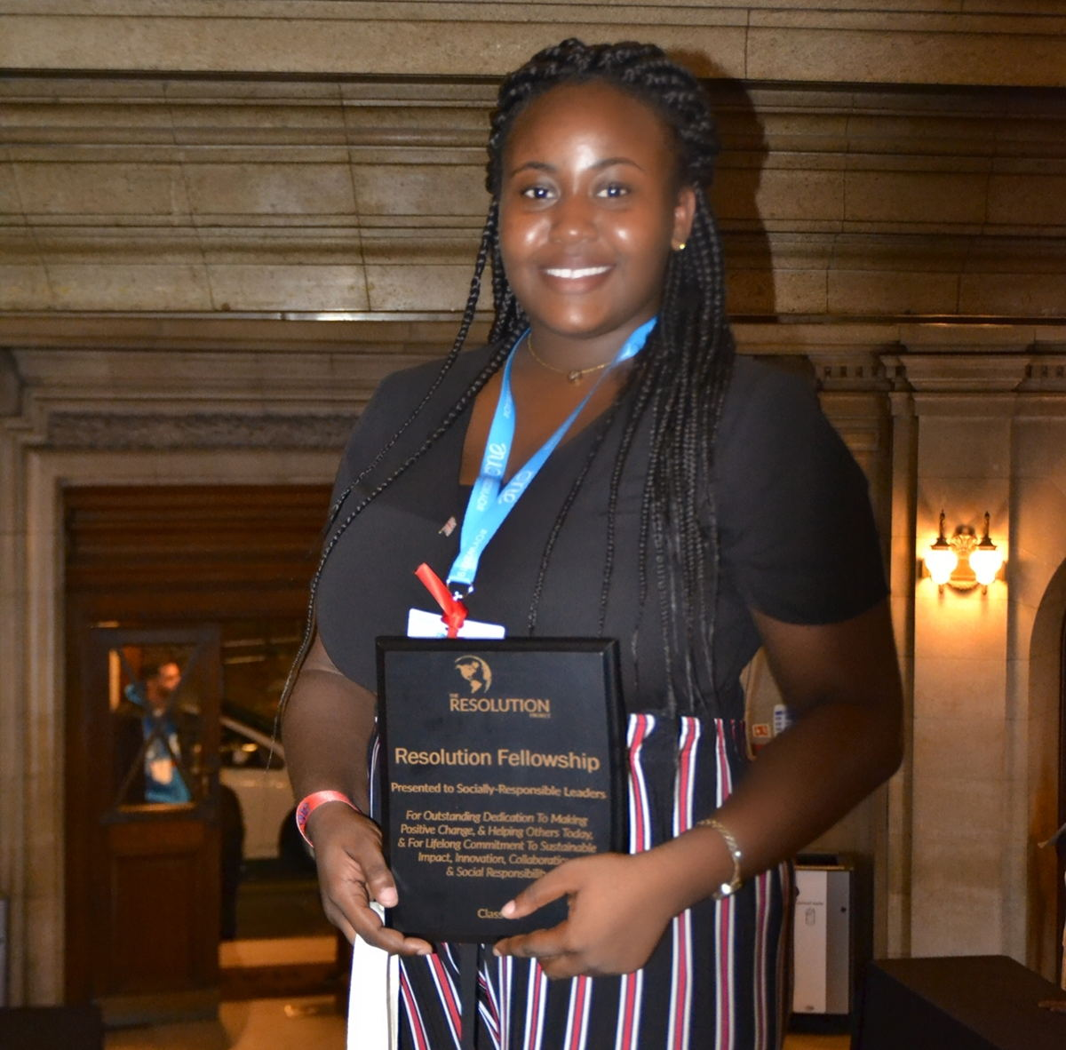 Jasmine receives her award and Fellowship package for YE!