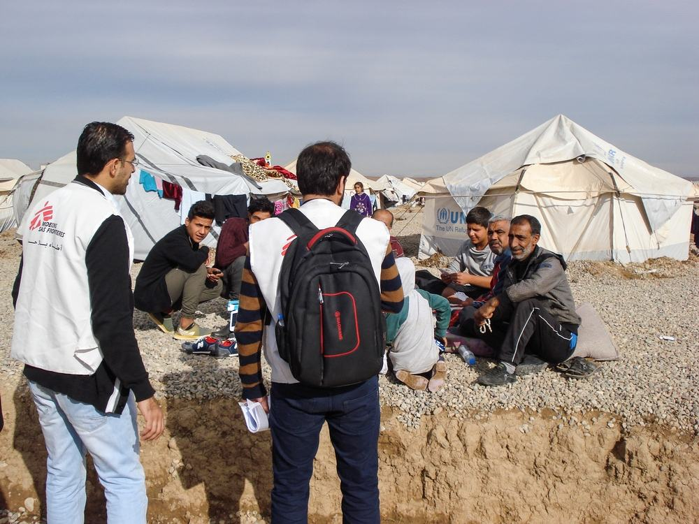 A counsellor is meeting families in the camp to explain them that they can consult a MSF psychiatrist or a MSF psychologist if they feel the need. Photographer: Brigitte Breuillac/MSF