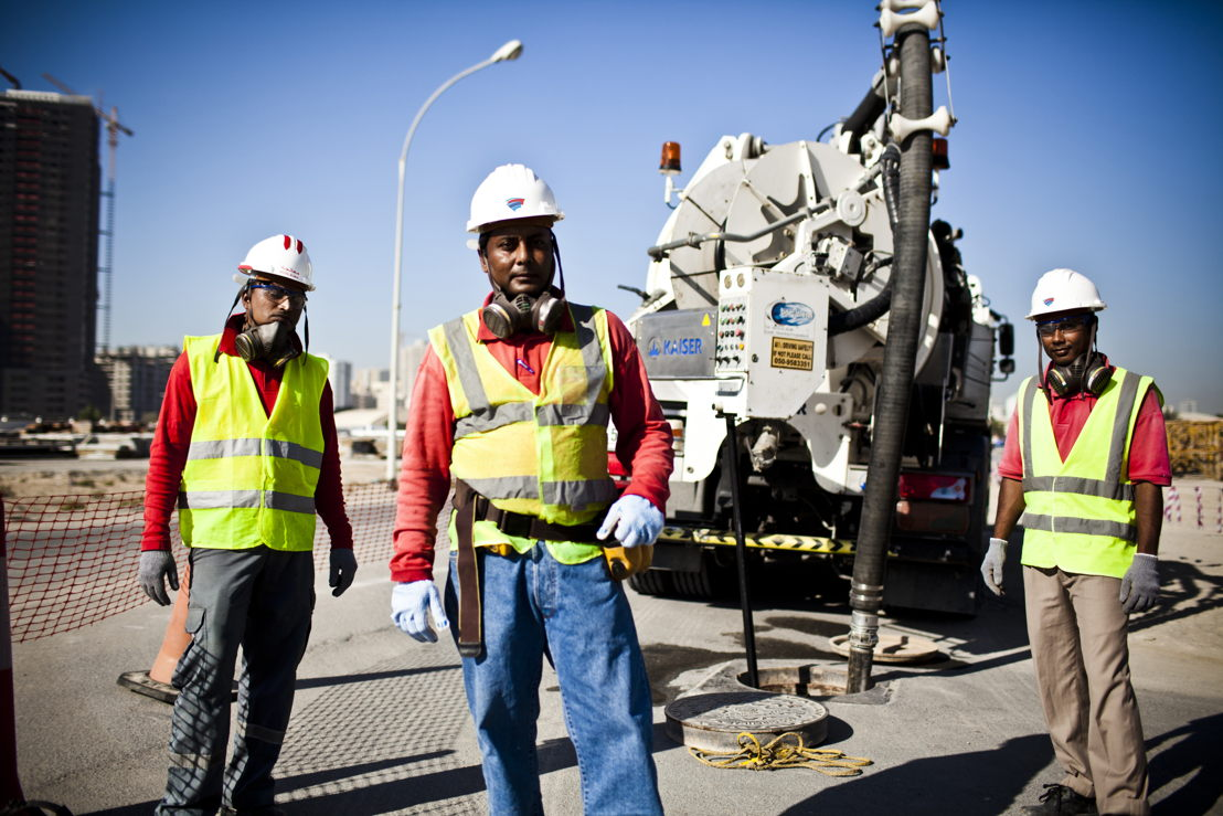 BESIX workers at a project site in Ajman.