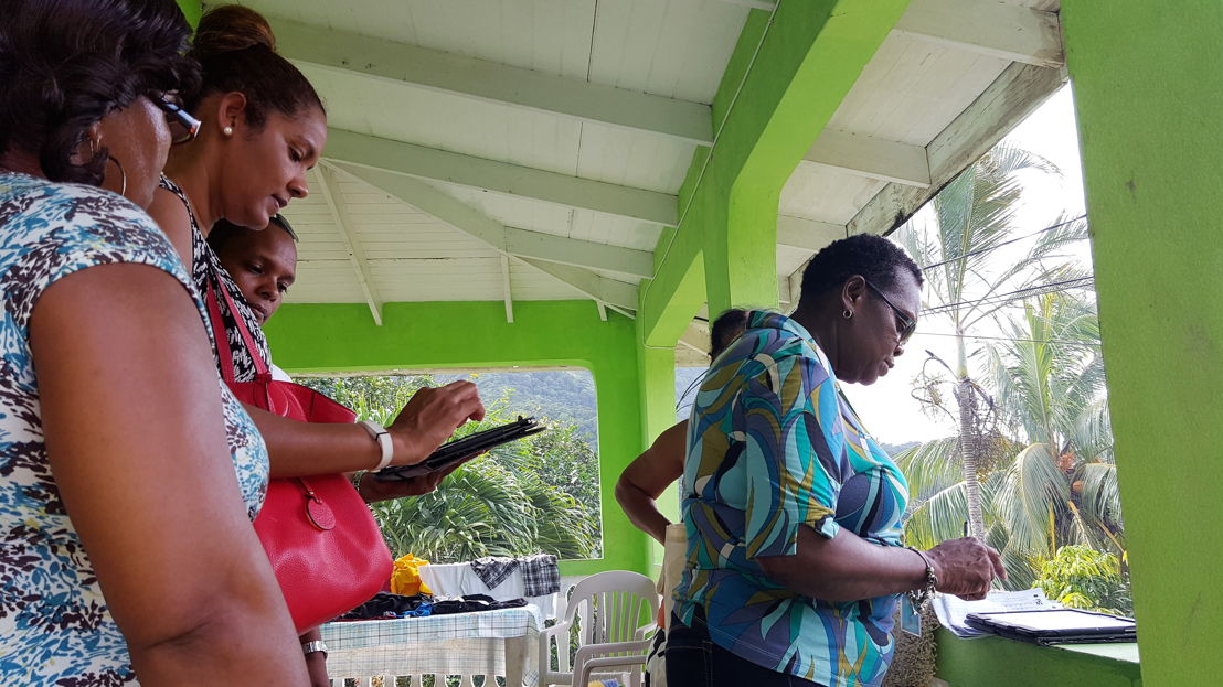 OECS Statistical Services Unit (SSU) and St. Lucia's Central Statistical Office (CSO) staff members conducting a survey with the use of tablets.