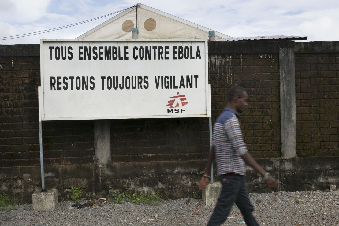 Outside the Medecins Sans Frontieres (MSF) health facility in Nongo. <br/><br/>A sign reads (in french): &#039;Tous Ensemble Centre Ebola Restons Toujours Vigilant&#039;<br/>(&quot;All together against Ebola, always remain vigilant&quot;). Photographer: Albert Masias