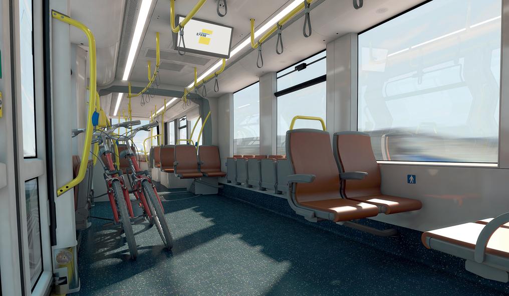 Interieur CAF-tram met zetels in recuperatieleder.