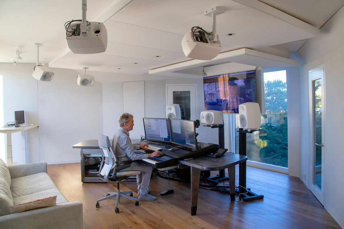 "Carter Burwell at composing/mixing position in his new 'The Body' Studio.  Not motorized 65"" flat screen in viewing position from ""flip-down"" ceiling mount."