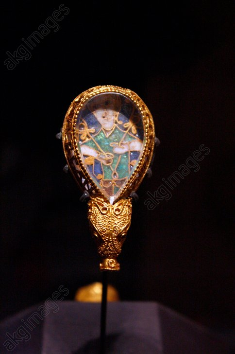 The Alfred Jewel is probably the single most famous archaeological object in England. It is comprised of a piece of cloisonne enamel depicting a human figure, though to be a representation of the sense of sight.<br/>AKG2087810