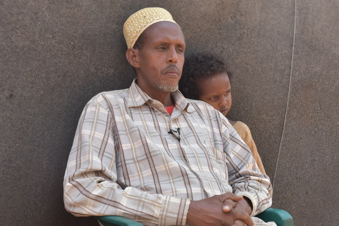 "Mohamed Farah Abdi arrived in Dadaab in 1992. He is pictured with his seven year old disabled son. <br/><br/>""When we fled, I was still a small boy. I don't see where I can go back to. I have fled from conflict, and now I have a disabled son who cannot even sit by himself. If I leave here, where will he get care? In Somalia, you will not find the services that we have here.<br/><br/>We will not be able to find proper health centres. If you are poor, you will require a lot of money to get healthcare. There are government hospitals to rely on for free medication."" Photographer: Mohamed Ali"