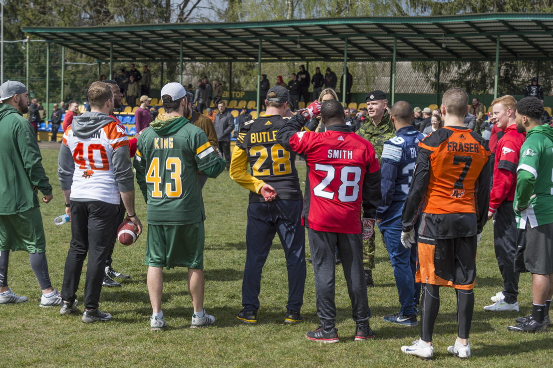 CFL players meeting with military members deployed on OP UNIFIER in Starychi, Ukraine. Photo: MCpl Mathieu Gaudreault, Canadian Forces Combat Camera