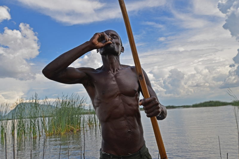 A fisherman on Lake Chilwa in Malawi takes an oral cholera vaccine as part of MSF's efforts to stem a cholera outbreak in Machinga, Phalombe and Zomba districts. Photographer: Aurelie Baumel/MSF