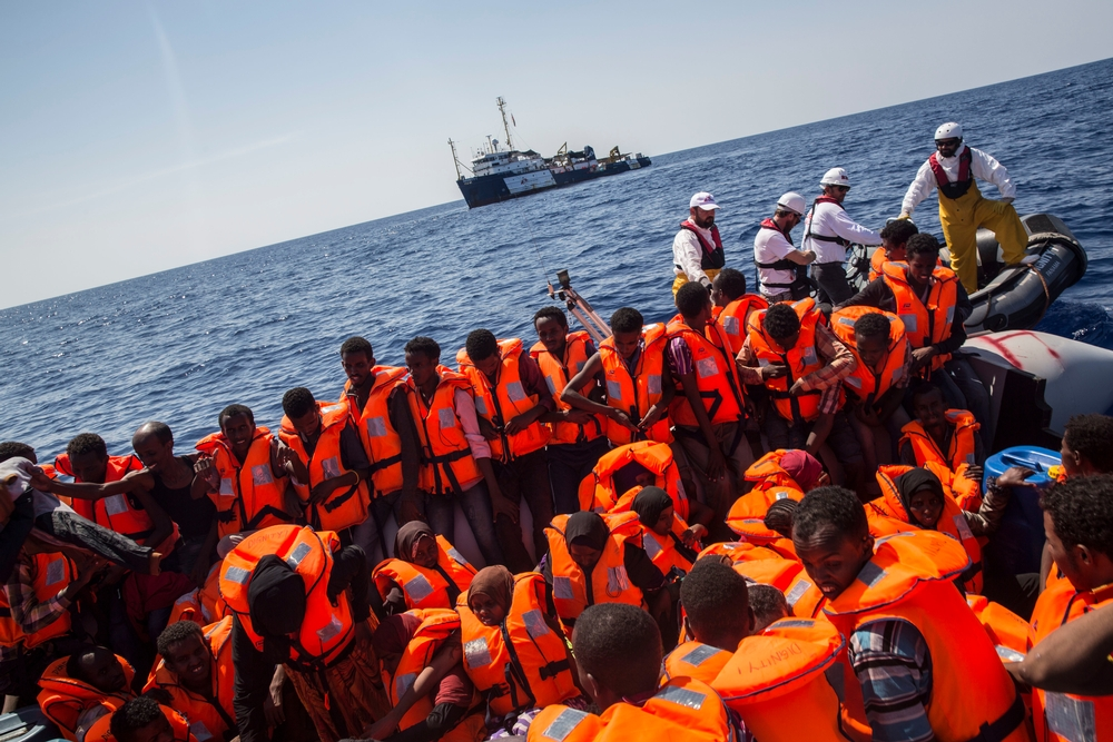 Photographer: Anna Surinyach<br/><br/>Caption: The Dignity I team conduct a rescue of people from a large, overcrowded, inflatable boat 02 September 2015, in the Mediterranean sea.