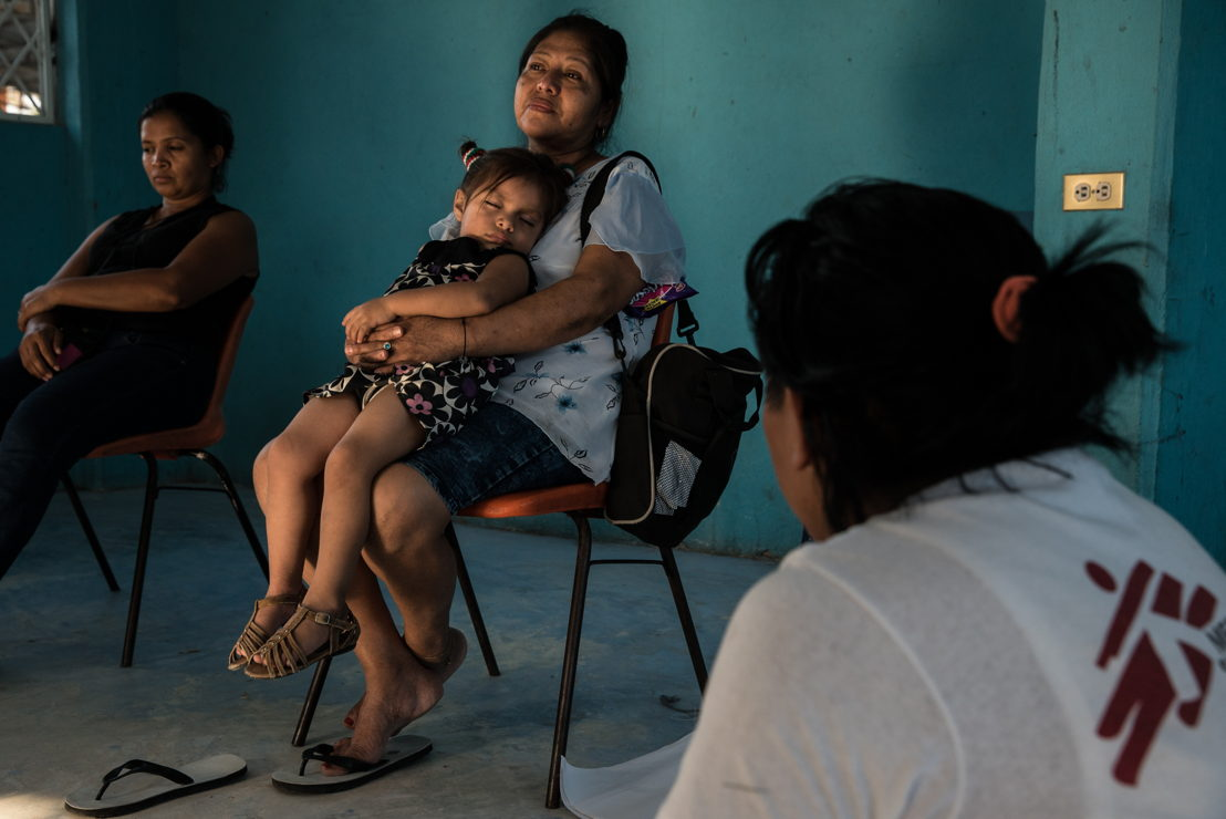 Mexico Migrants. A woman rests with her granddaughter during an MSF support session for women in the Tenosique migrant shelter. Photographer: Marta Soszynska