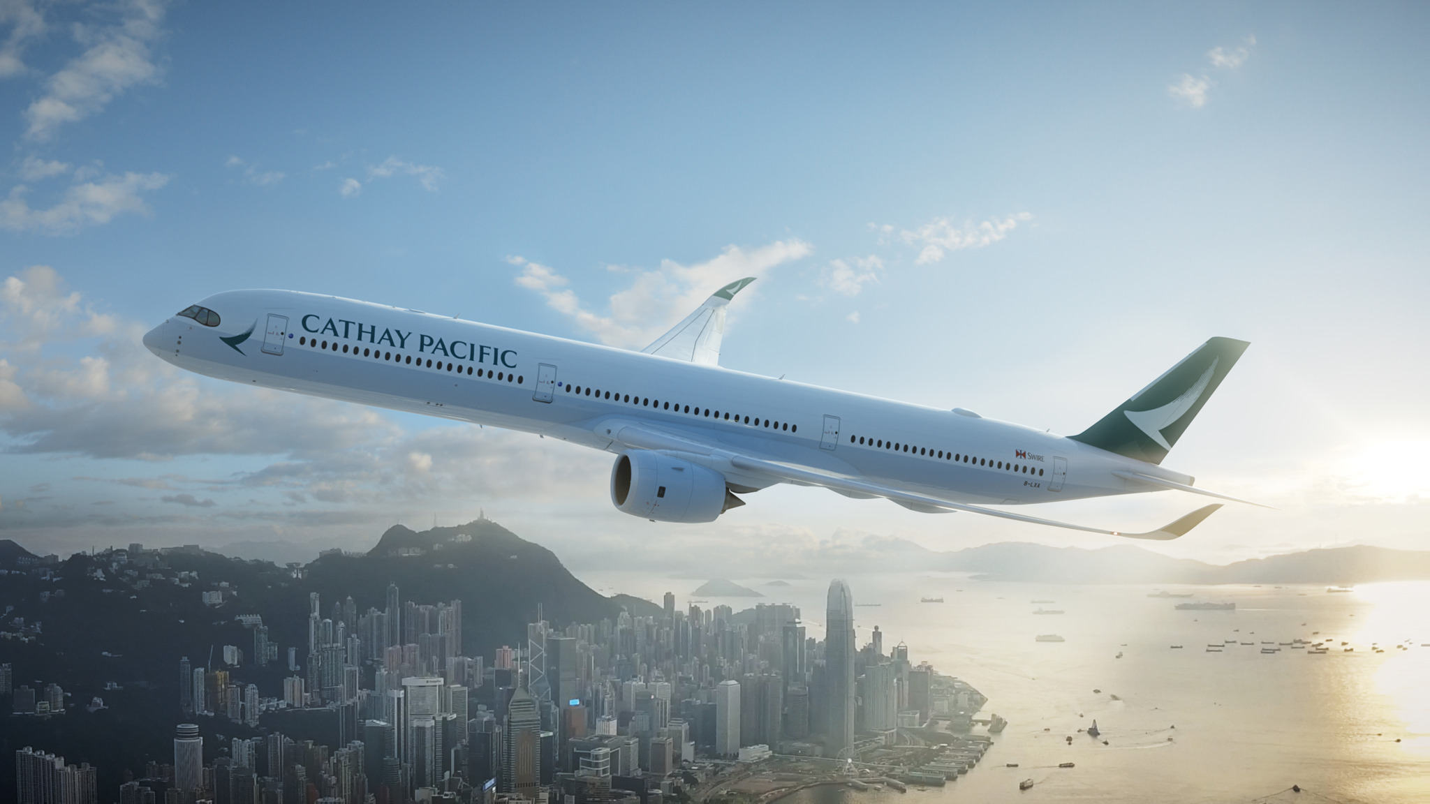 Cathay Pacific plane flying over a city