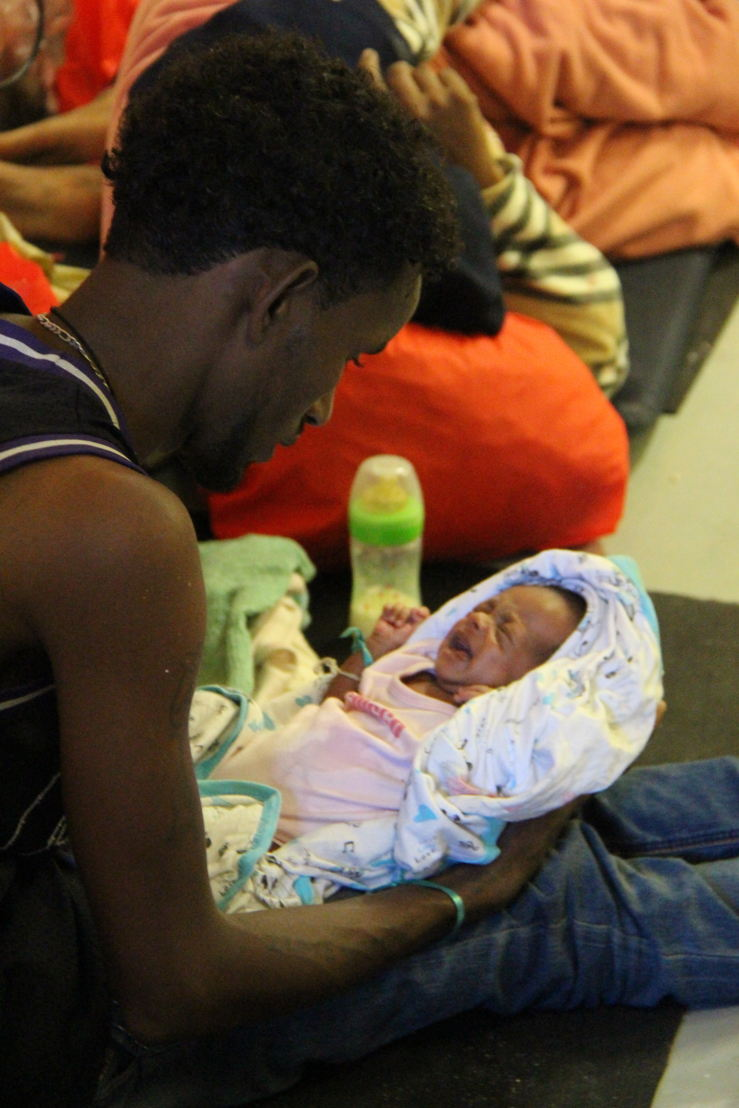 A single father holding his 1 week old baby; attempting the journey after his wife recently passed away. Photo: MSF