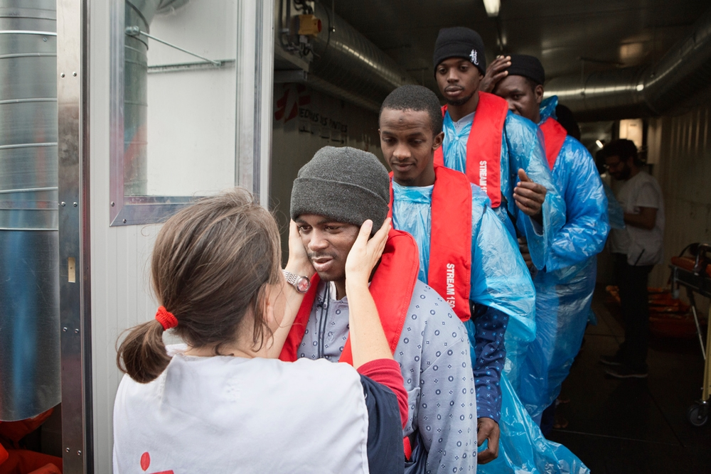 Photographer:  Alessandro Penso<br/><br/>Caption: Irene a medical coordinator with Doctors Without Borders (MSF) says goodbye to refugees and migrants as they disembark the Bourbon Argos and are transferred to a Norwegian vessel.