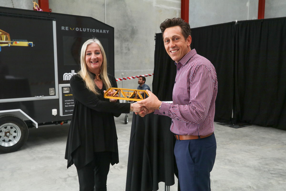 Vince presented a miniature of the new Demag V-type crane to Tracey Roberts, Mayor of the City of Wanneroo.