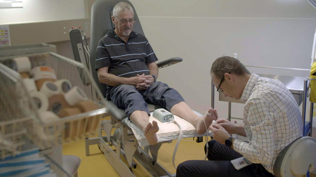 PARTICIPANT IAN DURING HIS FOOT CLINIC CONSULTATION