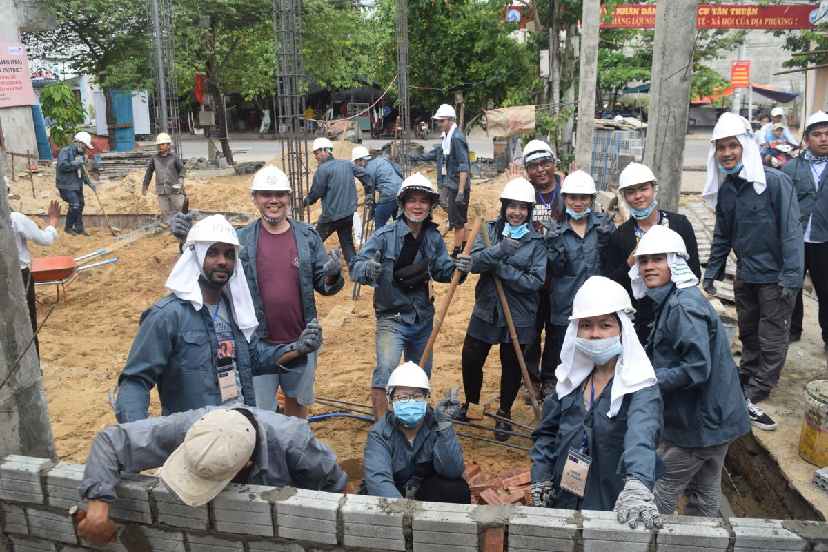 Our volunteers tirelessly building a community typhoon evacuation shelter that doubles up as a community centre for a local community in Vietnam.