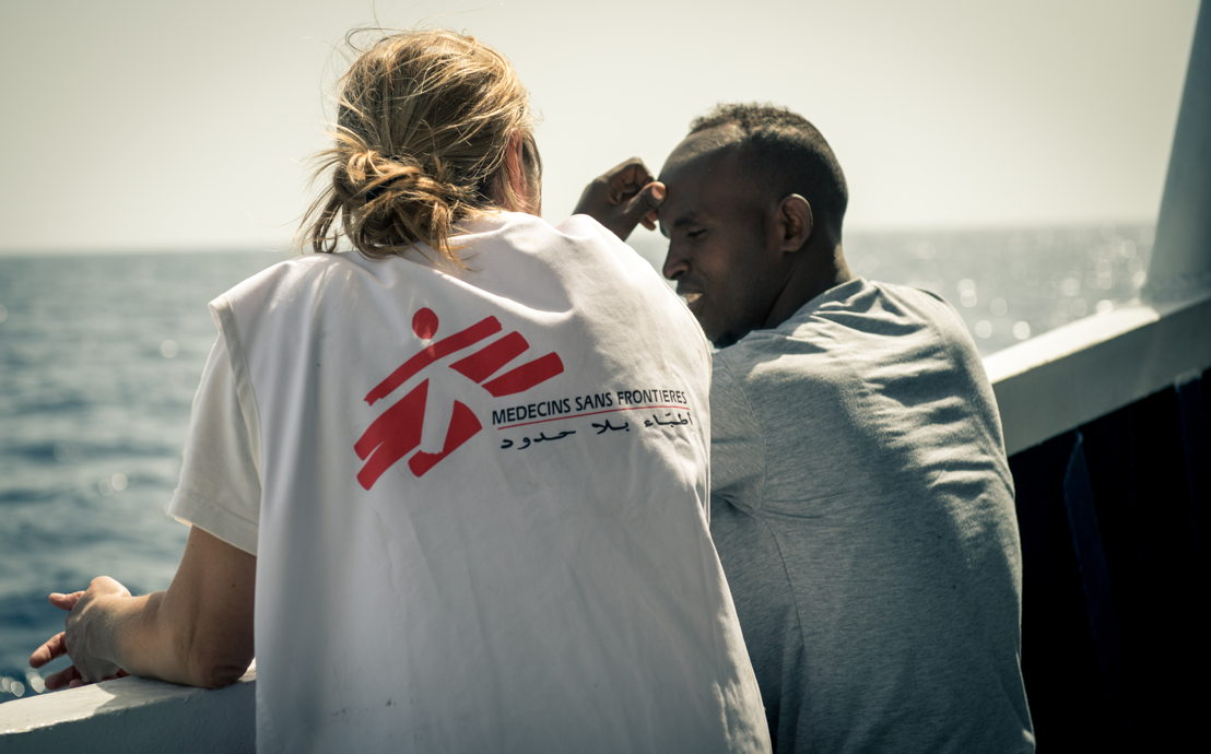 Credit: Gabriele François Casini / MSF Caption: Doctor Erna Rijnierse has a chat with an Eritrean man assisted on May 7th 2015. MY Phoenix search rescue and medical aid vessel jointly operated by MSF and MOAS successfully completed their second rescue of 2015. During the rescue 219 people were brought on board the MY Phoenix including 55 women (3 pregnant) and 33 children including 9 children under 5 and 2 babies of 3 month old and 1 year and four month. The majority of which were from Somalia and Syria. In the hours following the rescue the MSF triaged all patients and had consultations with those with medical issues.