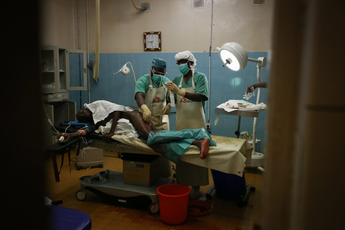 Operating theatre staff prepare a 20-year-old man for surgery, at the MSF supported hospital in Masisi, North Kivu, DRC. The man had been wounded by gunfire during intense fighting in Nyabiondo, a town in the Masisi area where MSF is supporting the health center. Photographer: Sara Creta