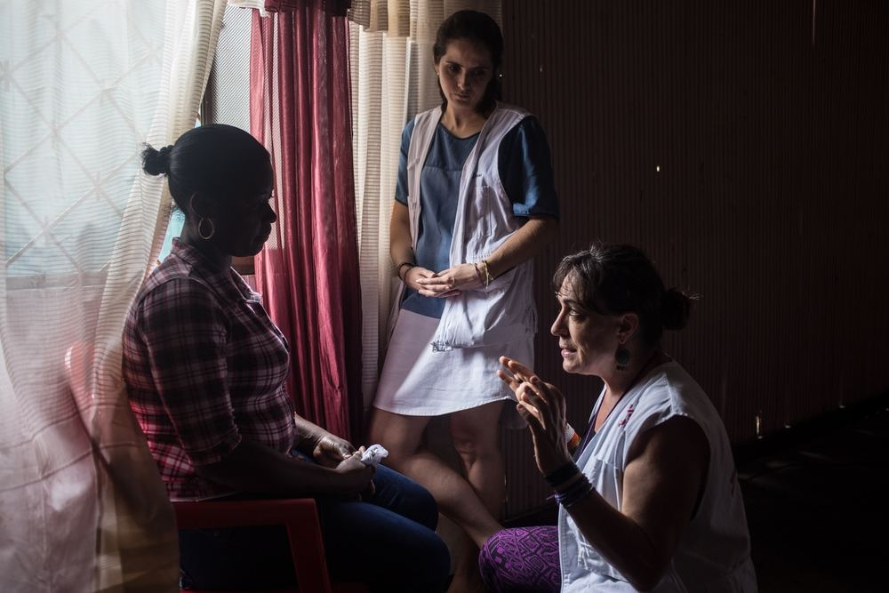 MSF psychologists carry out a consultation with a woman in Tumaco, Colombia. MSF teams provide comprehensive mental health support for victims of the armed conflict and other types of violence, especially sexual violence, in the urban area of Tumaco. Photographer: Lena Mucha/MSF
