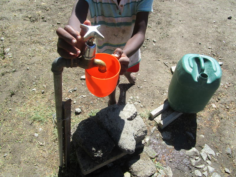 36.	This tap runs so slowly that the boy takes a long time to fill up his bottle with water. When even basic services are lacking or faulty, issues such as sexual violence can be overlooked. Photographer: Mitchelle Motswari