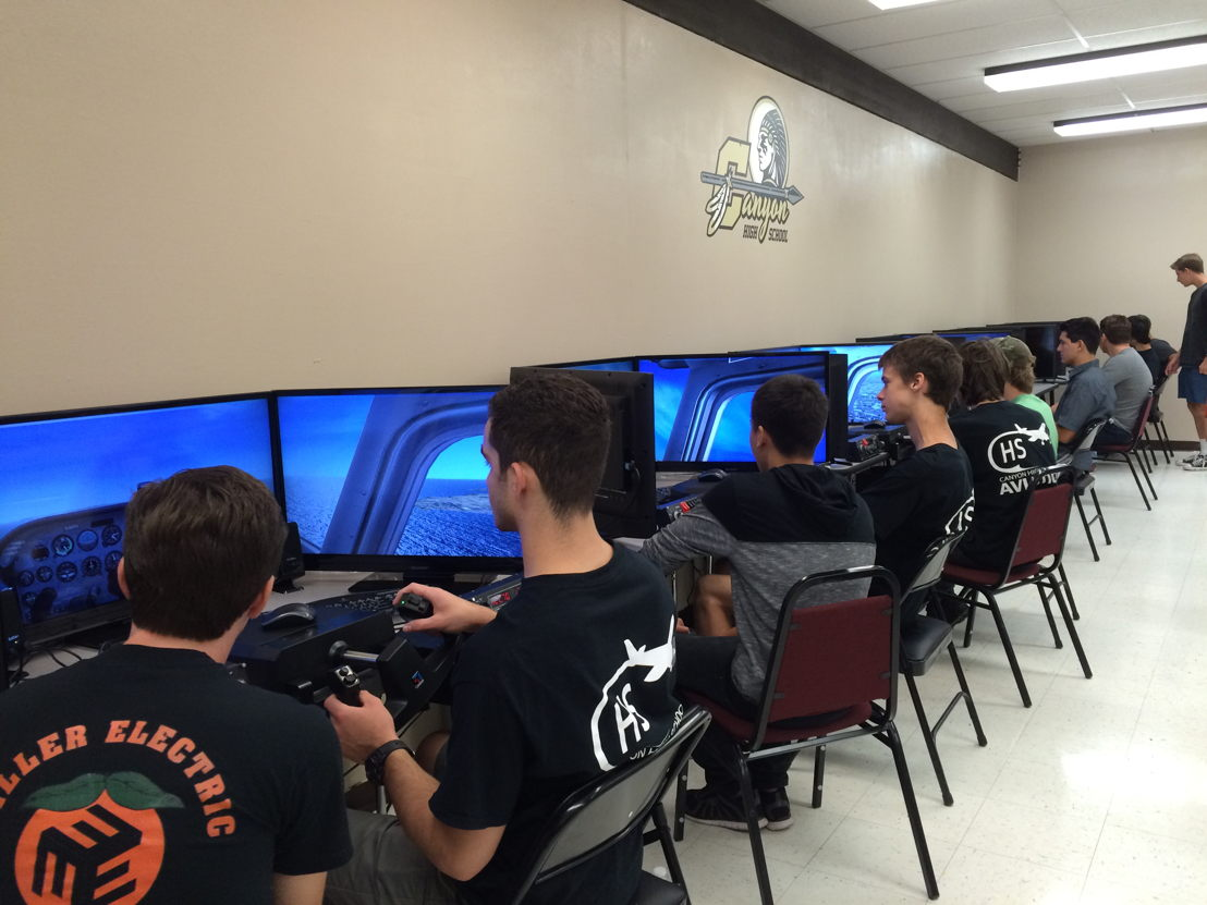 Students at Canyon High School practice actual flight training maneuvers in advanced simulators.