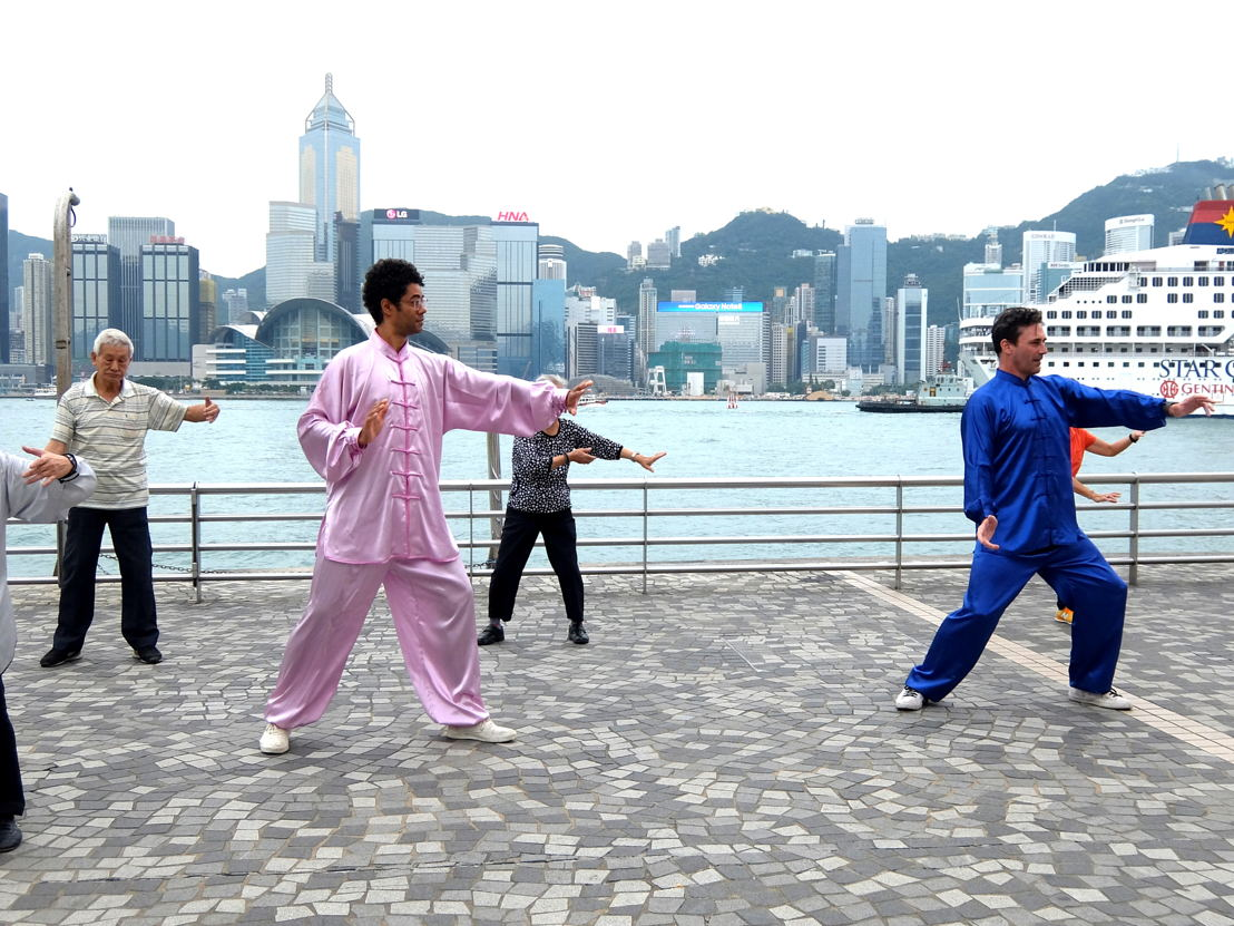 Richard Ayoade and Jon Hamm practised Tai Chi on the Tsim Sha Tsui promenade. Photo courtesy of North One Television and Channel 4.