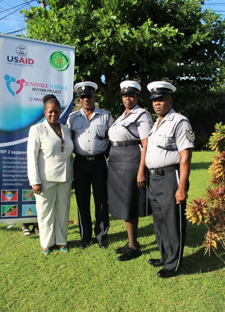 Ms. Gloria Septra Augustus with officers.