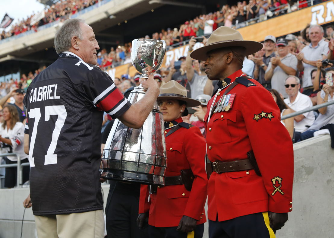 The Grey Cup makes its way onto the field at TD Place.