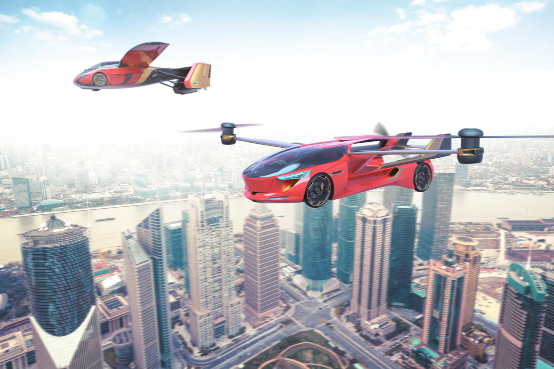 Design artist impression of AeroMobils flying over a city