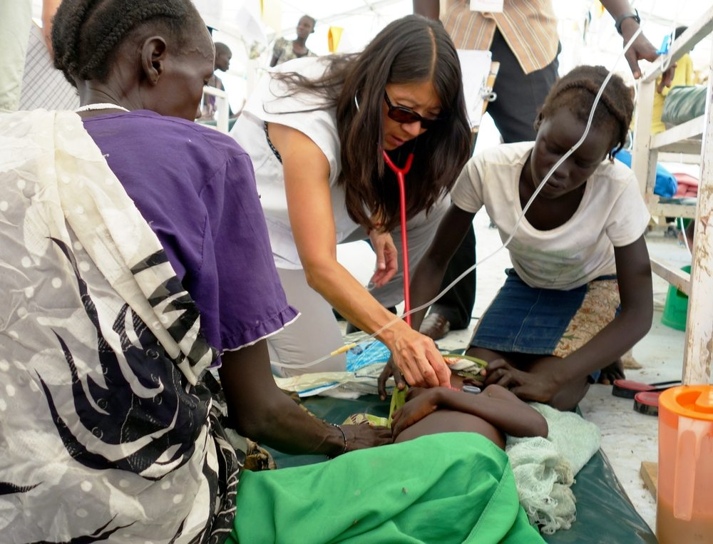 Dr. Joanne Liu examines a child suffering with severe malaria inside the 170+ bed MSF hospital serving the population of 108,000 seeking shelter inside the Bentiu Protection of Civilians Camp. The hospital was expanded by 60 beds since June as the population of the camp doubled in the period from June until September.