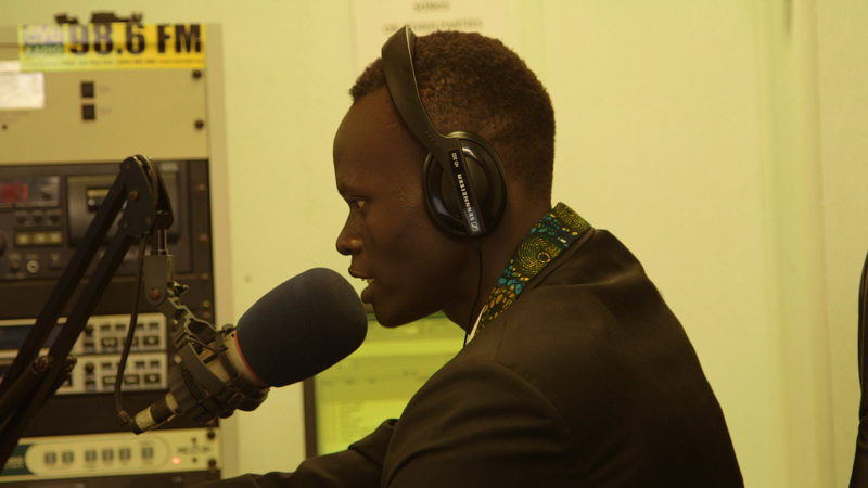 Radio presenter Tethluach Yong at mic