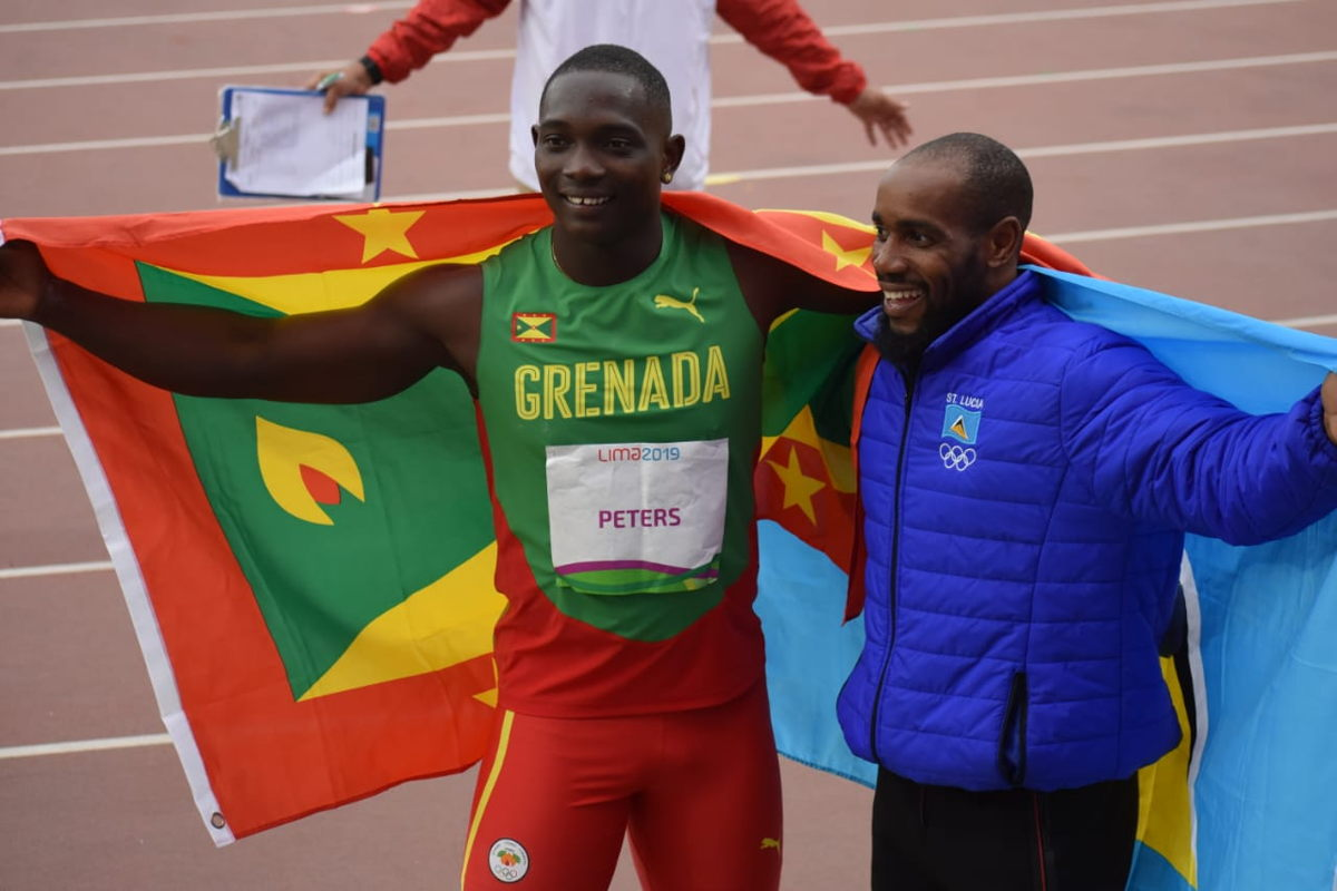 Anderson Peters (Grenada) and Albert Reynolds (Saint Lucia) men's javelin throw gold and bronze.  Photo Credit: Henry Bailey