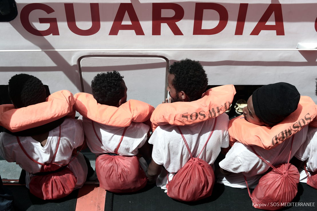 Aquarius is currently in the process of transferring 400 persons to two Italian Navy ships, at the request of the Italian MRCC. Aquarius was instructed by Maritime Rescue Coordination Centre in Rome to sail to Valencia to disembark the remaining 229 people.<br/><br/>While this appears to be a quick fix to the current political standoff, this should not set a precedent for future disembarkations. Rescued people should be disembarked in the nearest safe port available. Photographer: Kenny Karpov