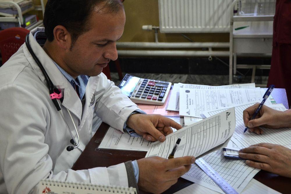 Dasht-e-Barchi Peaditrician doctor filling in paperwork. Photographer: Kate Stegeman/MSF
