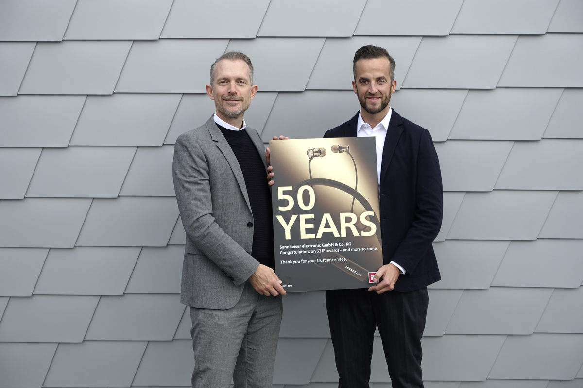 Frank Zierenberg (left), Project Director for iF, presents Oliver Berger (right), Global Head of Brand and Design Management for Sennheiser, with the certificate for 50 years of iF DESIGN AWARDS