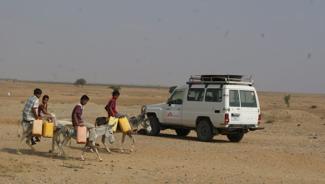 An MSF team on its way to a mobile clinic in Abs district, while four children on their donkeys go to fetch water. Water is one of the most pressing needs for displaced people, together with food, medication, shelter and protection. Rain is considered to be a destabilising factor, as it floods tents and rudimentary houses. Photographer: Gonzalo Martinez. Date photo taken: 05 March, 2017