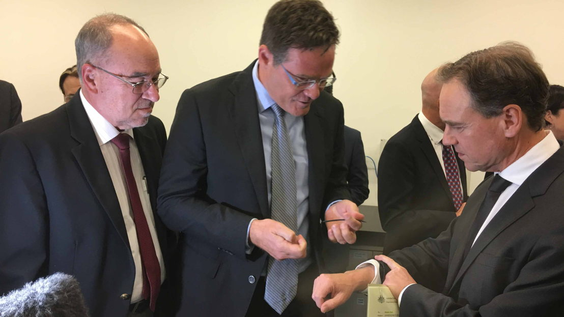 (L to R) ANU Provost Professor Mike Calford, Professor Mark Kendall and Health Minister The Hon Greg Hunt MP wearing the new technology.