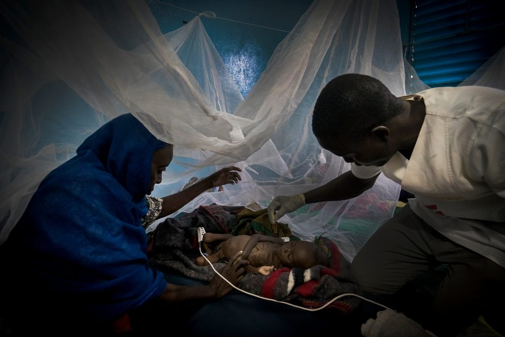 System identifier<br/>: MSF145894<br/>Title<br/>: Meningitis Epidemic in Niger<br/>Photographer / cameraman<br/>: Sylvain Cherkaoui<br/>Countries:<br/>Niger<br/>Description<br/>: Patients wait their turn to come in the ambulatory