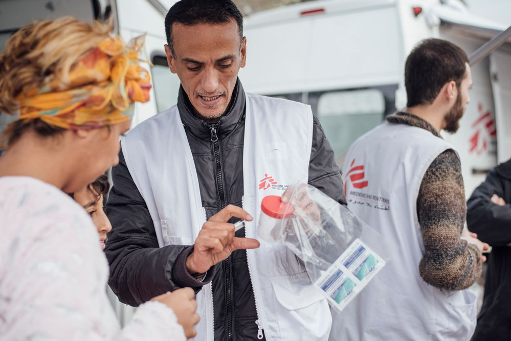 MSF Cultural Mediator Lofti Jenboudi talks to a patient on Lesbos, 8 January 2018. Credit Kevin McElvaney/MSF,