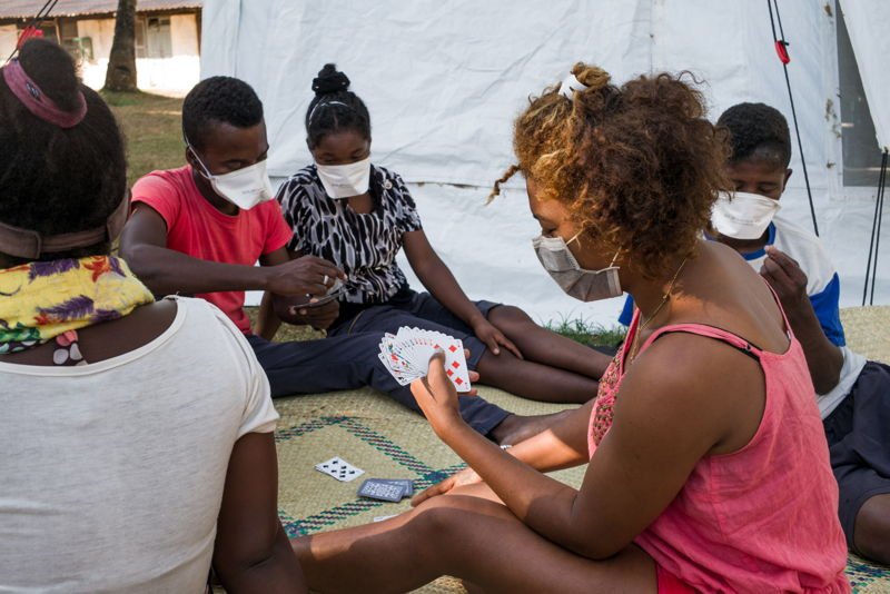 """TOAMASINA, MADAGASCAR - MARIE Florencia (right), 22 is being treated in the Plague Triage and Treatment Center she's playing cards with the other patients to pass the time whilst she recovers. She was diagnosed and admitted in the care centre on the 17th of October. """"I'm a waitress in a bar in Toamasina. I hope that my boss will accept to work with me when I'm cured and able to leave."""" Photographer: RIJASOLO/Riva Press"""