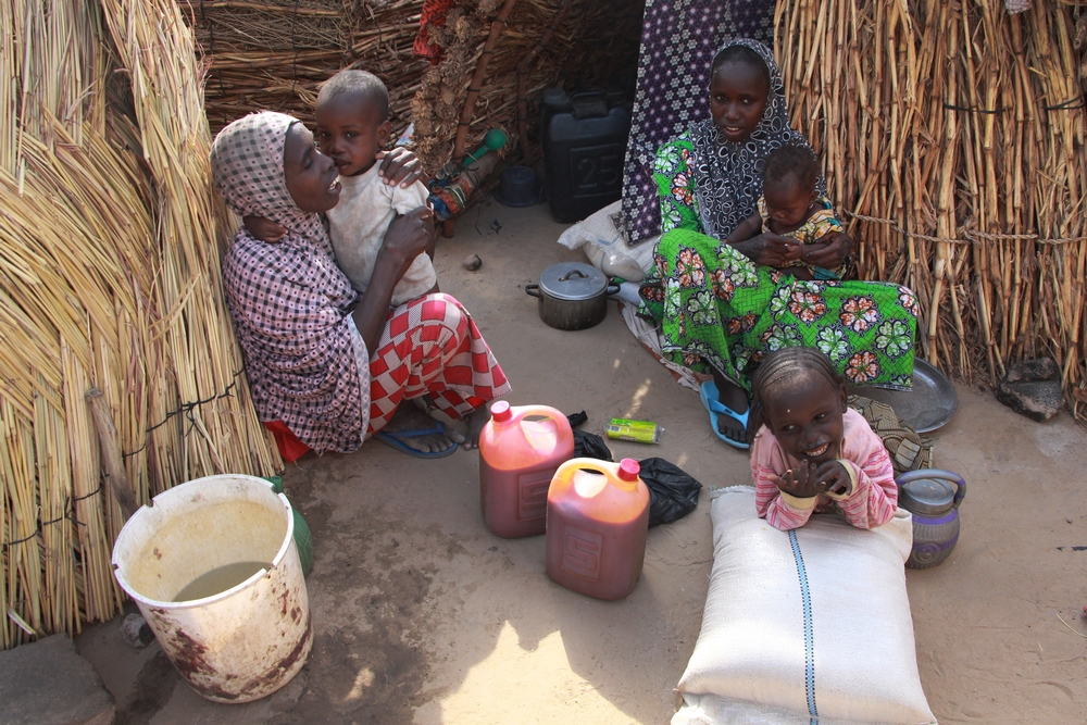 Maira Modu, 30, (left) who has six children, fled her village in Bama one year ago following an attack. They have been living in a camp in Maiduguri ever since.  Photographer: Malik Samuel/MSF