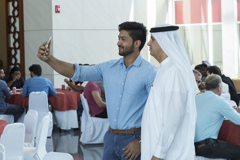 Dr Ahmad Al Ali, Senior Vice President of Emirates Aviation University connecting with a former student.