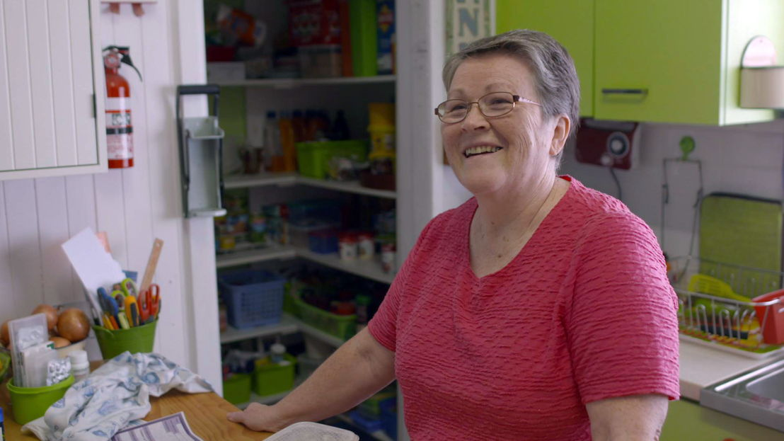 PARTICIPANT ANN AT HOME IN HER KITCHEN