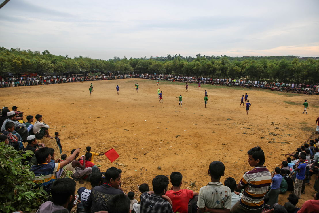 Nearly every day, Rohingya refugees gather to play football at the Tasnimarkhola camp. Photographer: Mohammad Ghannam