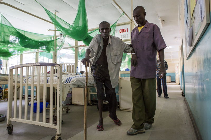 Homa Bay, Kenya: John, 56 years, was diagnosed with HIV in 2015 and has been taking antiretrovirals ever since. He was admitted in Homa Bay hospital in July 2017 with back and chest pain, and needs assistance for most tasks. <br/><br/>Around 65% of AIDS admissions to the hospital have already been on antiretrovirals before, with 50% showing some form of treatment failure. Photographer: Patrick Meinhardt